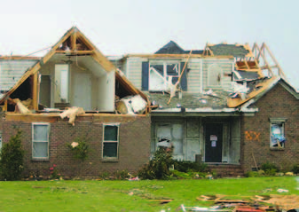 This home in Fayetteville, N.C., lost gable-end trusses at two locations on the roof during an April 2011 tornado.
