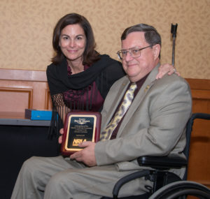 David Moore receives the Paul S. Collier Award from NRLA President Rita Ferris.