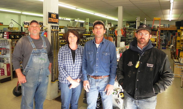 Photo courtesy of Doug Davidson, Houston Herald Ross Lumber owners Jimmy and Alicia Swindell, center, stand with staff members Danny Kuhn, left, and Adam Bates.